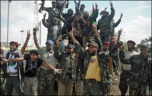 "Militia members celebrate a victory. In the absence of any effective central authority, an estimated several hundred militias in 2012 had grown to approximately 1,700 by early 2015. Funds from various sources, such as the Muslim Brotherhood-affiliated ""Libya Shield Force,"" have enhanced their recruitment potential and diminished the power and effectiveness of the national army."