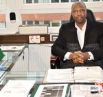 Hon. Kenneth Gbandi in his Office in Hamburg/Photo: African Heritage
