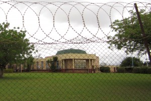 Swaziland's parliament protected by barbed wire/Photo: Peter Kenworthy