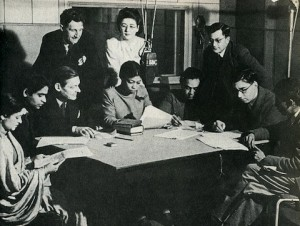 Una Marson (seated at centre) with T.S. Eliot, George Orwell, and other writers in a BBC studio, 1942