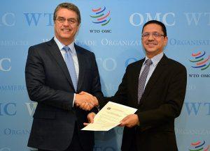 Nepal's WTO ambassador, Deepak Dhital, presents his country's TFA instrument of acceptance to DG Azevêdo/Photo: WTO